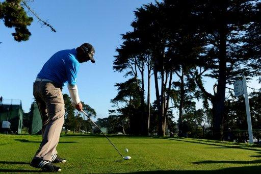 Andy Zhang of China hits a tee shot during a practice round