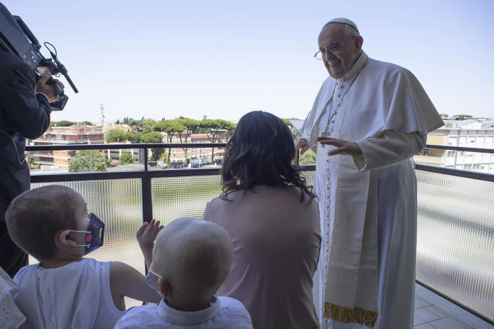 Pope Francis appears with some young oncologic patients at a balcony of the Agostino Gemelli Polyclinic in Rome, Sunday, July 11, 2021, where he was hospitalized for intestine surgery, to deliver his traditional Sunday blessing. (Vatican Media via AP)