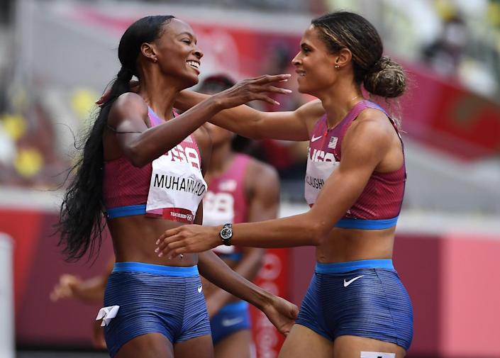 Sydney McLaughlin and Dalilah Muhammed embrace on the track at the Tokyo Olympics.