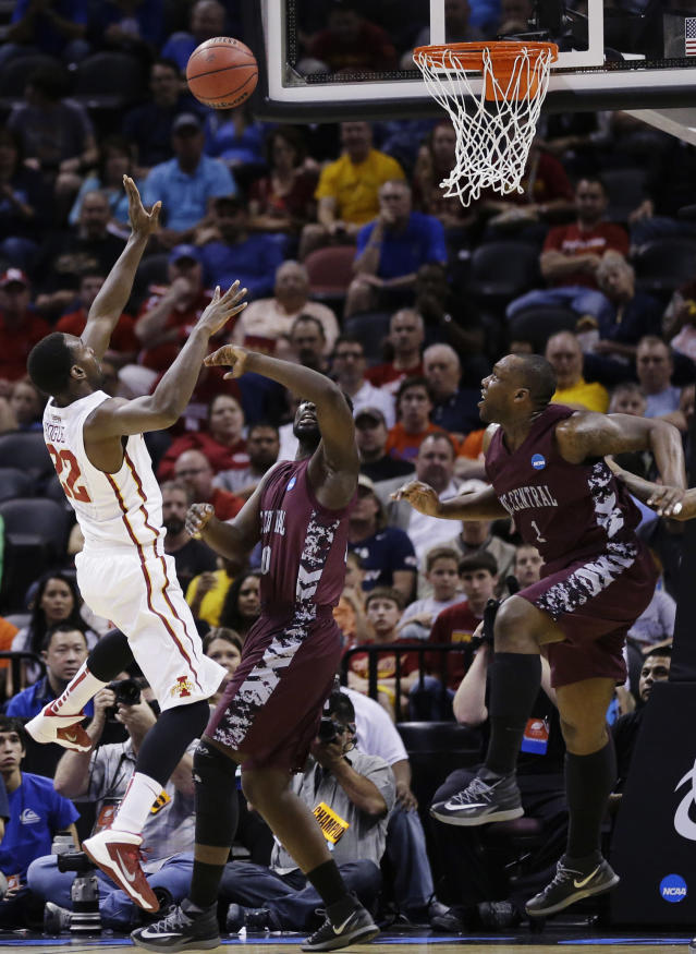 Iowa State forward Dustin Hogue (22) shoots over North Carolina Central forward Karamo Jawara (10) and forward Jay Copeland (1) during the first half of a second-round game in the NCAA college basketball tournament Friday, March 21, 2014, in San Antonio. (AP Photo/Eric Gay)