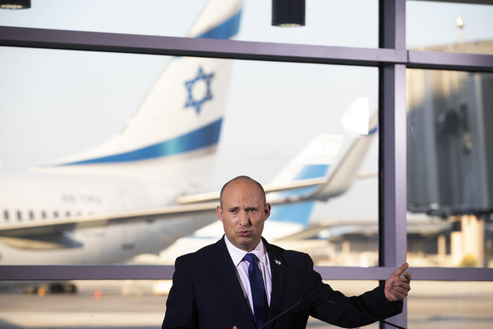 FILE - In this June 22, 2021 file photo, Israel's Prime Minister Naftali Bennett speaks to journalists after touring Ben Gurion Airport, with the Minister of Health Nitzan Horowitz and the Minister of Transportation Merav Michaeli. New leaders of the American and Israeli governments are resetting their countries' relationship after years of divisiveness. (AP Photo/Maya Alleruzzo)