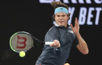 Canada's Milos Raonic hits a forehand return to Serbia's Novak Djokovic during their fourth round match at the Australian Open tennis championship in Melbourne, Australia, Sunday, Feb. 14, 2021.(AP Photo/Hamish Blair)