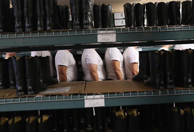 <p>New U.S. Border Patrol trainees wait to be fitted for uniforms at the U.S. Border Patrol Academy on August 3, 2017 in Artesia, N.M. (Photo: John Moore/Getty Images) </p>