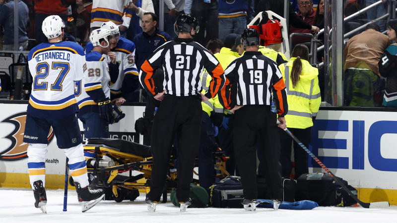 ANAHEIM, CA - FEBRUARY 11: The St. Louis Blues watch as the paramedics tend to Jay Bouwmeester #19 of the St. Louis Blues after he collapsed on the bench during the first period of the game against the Anaheim Ducks at Honda Center on February 11, 2020 in Anaheim, California. (Photo by Debora Robinson/NHLI via Getty Images)