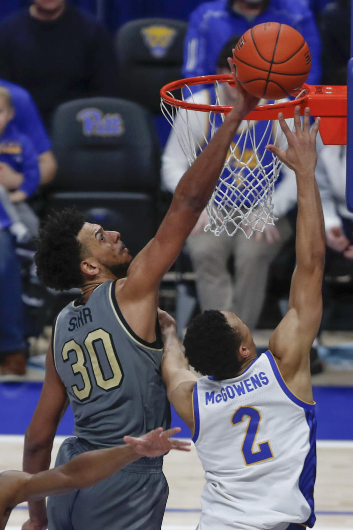 Wake Forest's Olivier Sarr (30) blocks a shot by Pittsburgh's Trey McGowens (2) in the closing seconds of the second half of an NCAA college basketball game, Saturday, Jan. 4, 2020, in Pittsburgh. Wake Forest won 69-65. (AP Photo/Keith Srakocic)
