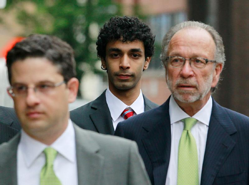 Dharun Ravi, center, walks into the Middlesex County Courthouse for a hearing in the webcam-spying case involving the suicide of Rutgers University student Tyler Clementi, Monday, May 23, 2011, in New Brunswick, N.J. Ravi is one of two former Rutgers students accused of spying on Clementi's intimate encounter with another man days before the classmate committed suicide. (AP Photo/Julio Cortez)