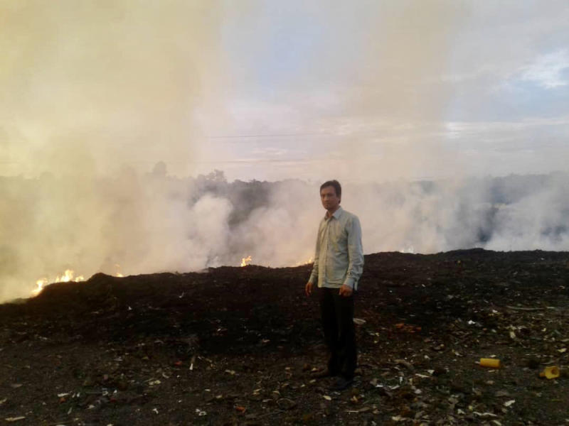 Pasir Gudang Municipal Council (MPPG) Mohd Nasir Mohd Yunus standing at the site of the burning solid waste landfill. — Pictures by Amni Jagat