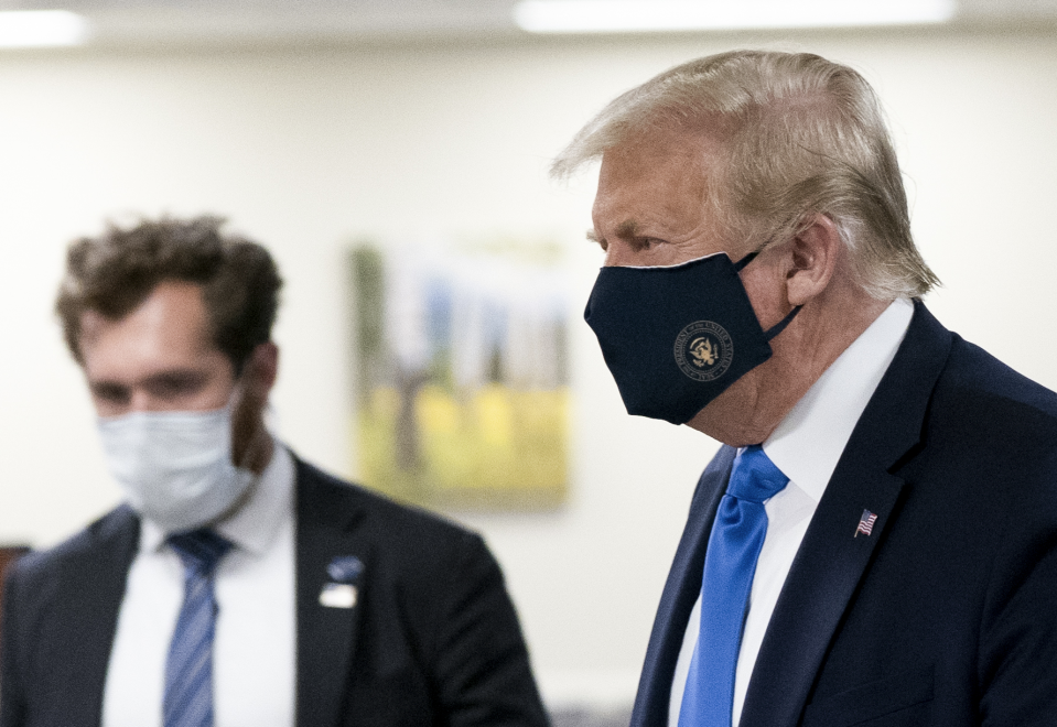 U.S. President Donald Trump wears a protective mask while visiting Walter Reed National Military Medical Center in Bethesda, Maryland, U.S., on Saturday, July 11, 2020. (Chris Kleponis/Polaris/Bloomberg via Getty Images)