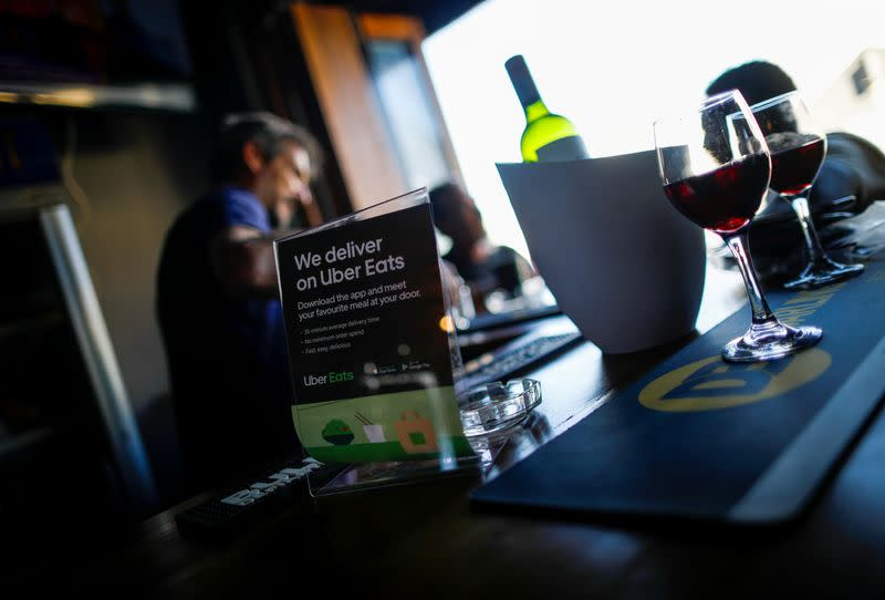 FILE PHOTO: A flyer advertising Uber Eats delivery service is pictured at a restaurant in Cape Town