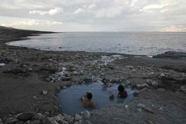 Tourists enjoy a spring water pool along the Dead Sea shore. Experts have warned the Dead Sea is on course to dry out by 2050
