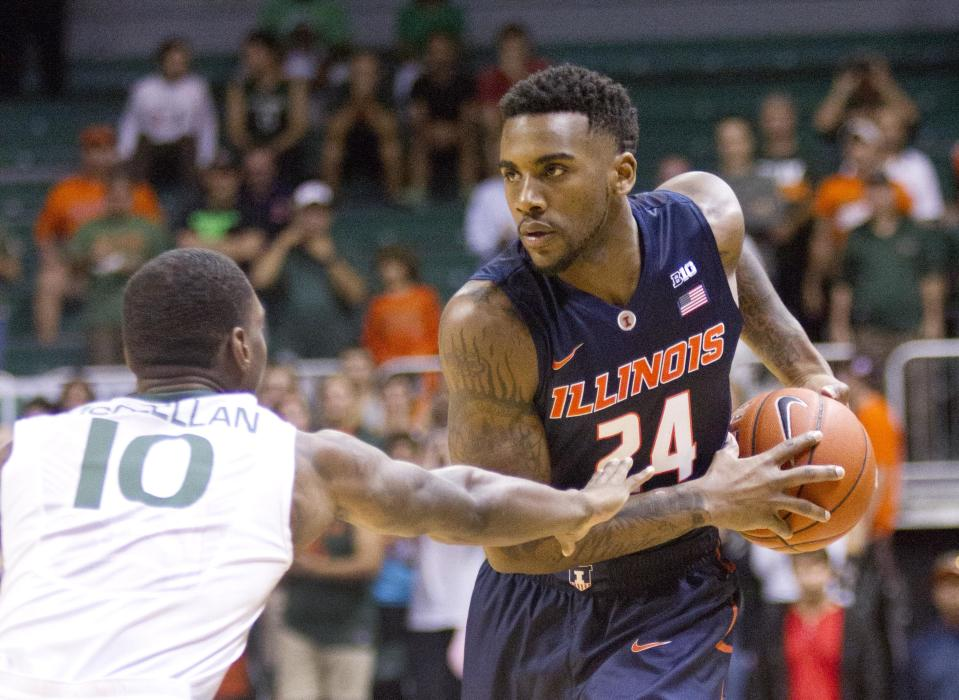 Illinois guard Rayvonte Rice (24) looks for an open teammate past Miami guard Sheldon McClellan (10) during the first half of an NCAA college basketball game, Tuesday, Dec. 2, 2014 in Coral Gables, Fla. (AP Photo/Wilfredo Lee)