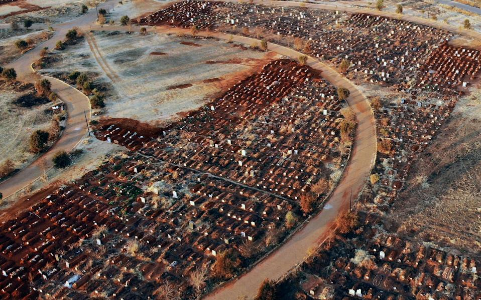 Recently filled graves are seen in the Olifantsveil Cemetery outside Johannesburg, South Africa, Wednesday Aug. 5, 2020. - Jerome Delay /AFP