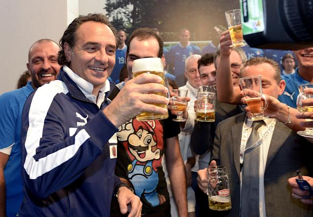 KRAKOW, POLAND - JUNE 29: Italy head coach Cesare Prandelli celebrates with a beer during a press conference following the team's victory in the UEFA EURO 2012 semi-final against Germany and ahead of their final against Spain at Casa Azzurri on June 29, 2012 in Krakow, Poland. (Photo by Claudio Villa/Getty Images)