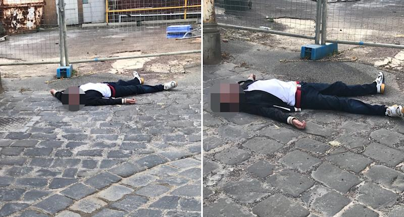 A man pictured collapsed on a Richmond street in Melbourne.