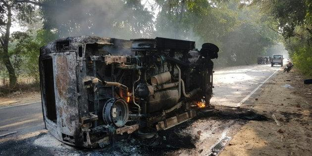 An upturned vehicle seen after a mob violence at Chingravati village in Bulandhahr.
