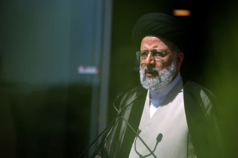 Presidential candidate Ebrahim Raisi speaks with journalists before the start of the last election debate, in Tehran