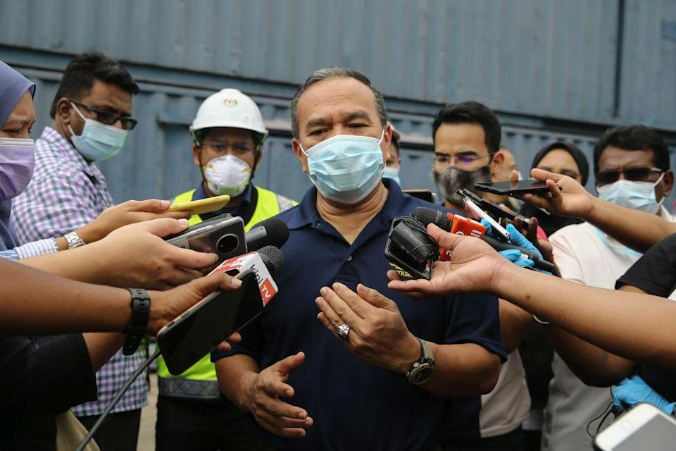Human Resources Ministry deputy director-general Mohd Asri Abdul Wahab speaks to reporters following a raid on the premises of a glove manufacturer in Klang December 24, 2020. — Picture by Yusot Mat Isa