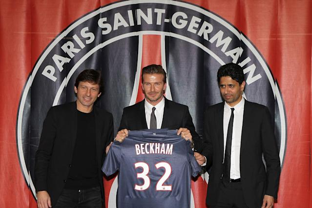 PARIS, FRANCE - JANUARY 31: (L-R) PSG director of football Leonardo, International soccer player David Beckham and president of PSG Nasser Al-Khelaifi pose with the PSG Football shirt after Beckham PSG signature at Parc des Princes on January 31, 2013 in Paris, France. (Photo by Marc Piasecki/Getty Images)