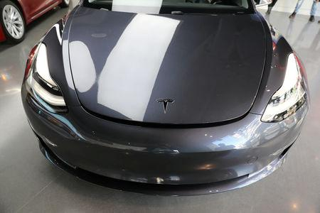 FILE PHOTO: A Tesla Model 3 is seen in a showroom in Los Angeles