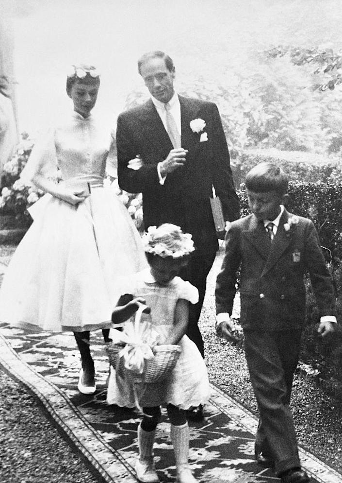 <p>Audrey Hepburn and Mel Ferrer managed to wed in secret at a lodge in Switzerland in 1954. The bride wore a tea length Balmain dress for the outdoor ceremony. </p>