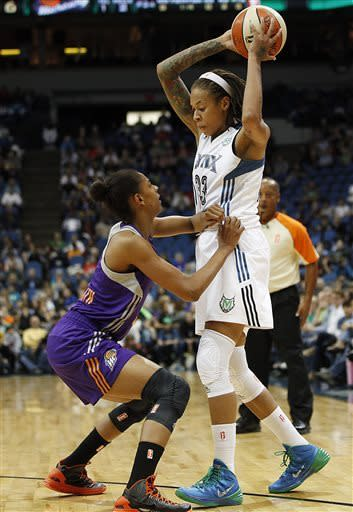 Minnesota Lynx Seimone Augustus (33) protects the ball from Phoenix Mercury guard Briana Gilbreath (15) in the first half of a WNBA basketball game, Thursday, June 6, 2013, in Minneapolis. (AP Photo/Stacy Bengs)