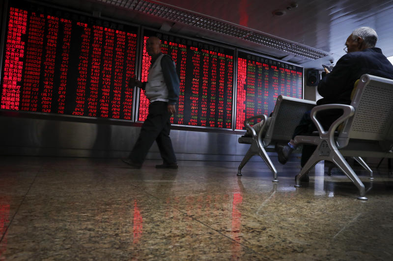 Chinese investors monitor stock prices at a brokerage house in Beijing, Thursday, Nov. 28, 2019. Asian shares were mostly lower on Thursday after President Donald Trump signed a bill expressing support for human rights in Hong Kong. (AP Photo/Andy Wong)
