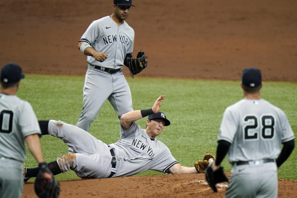 New York Yankees third baseman DJ LeMahieu makes a diving catch on an infield popout by Tampa Bay Rays' Mike Zunino during the second inning of a baseball game Friday, April 9, 2021, in St. Petersburg, Fla. (AP Photo/Chris O'Meara)