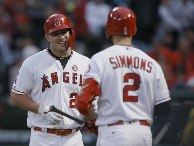 Los Angeles Angels' Mike Trout, left, gets congratulations from Andrelton Simmons after hitting a solo home run against the Kansas City Royals during the first inning of a baseball game in Anaheim, Calif., Saturday, May 18, 2019. (AP Photo/Alex Gallardo)