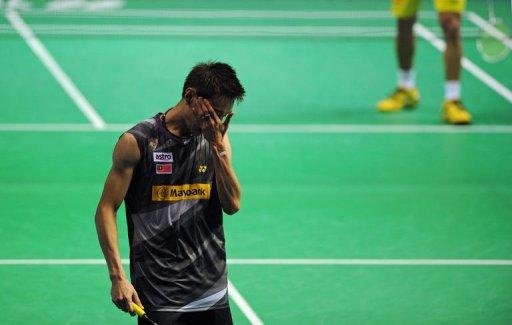 Lee Chong Wei of Malaysia reacts to losing a point to Lin Dan of China in their men's singles semi-final match at the China Open badminton tournament in Shanghai. Lin Dan delighted home fans as he made it back-to-back victories against arch-rival and number one seed Lee Chong Wei of Malaysia to reach the men's singles final at the China Open on Saturday