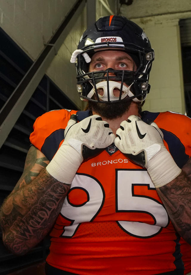 Denver Broncos defensive end Derek Wolfe gets ready to take the field during an NFL football game between the Denver Broncos and the Chicago Bears, Sunday, Sept. 15, 2019, in Denver. (AP Photo/Jack Dempsey)