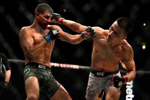 (L-R) Yair Rodriguez and Chan Sung Jung exchange punches in their featherweight bout during the UFC Fight Night event inside Pepsi Center on Nov. 10, 2018 in Denver, Colorado. (Chris Unger/Zuffa LLC via Getty Images)