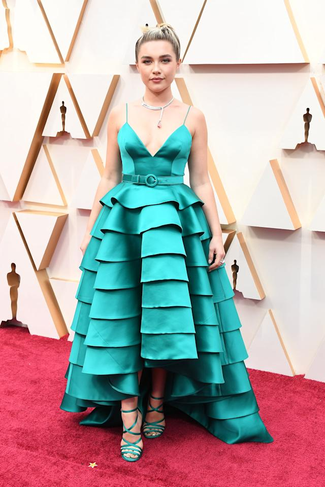 "<p>Walking the red carpet in a gorgeous <a href=""https://www.popsugar.com/fashion/florence-pugh-oscars-dress-2020-47196210"" class=""ga-track"" data-ga-category=""Related"" data-ga-label=""https://www.popsugar.com/fashion/florence-pugh-oscars-dress-2020-47196210"" data-ga-action=""In-Line Links"">turquoise tiered Louis Vuitton gown</a>.</p>"