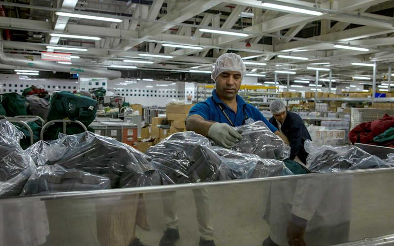 Items like amenity packs are also prepared at the catering facility in Dubai. | Talia Avakian