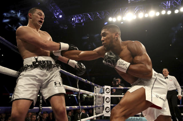 Anthony Joshua (R) battles against Joseph Parker during their WBA, IBF and WBO heavyweight champion at the Principality Stadium in Cardiff, Wales, Saturday March 31, 2018. (AP)