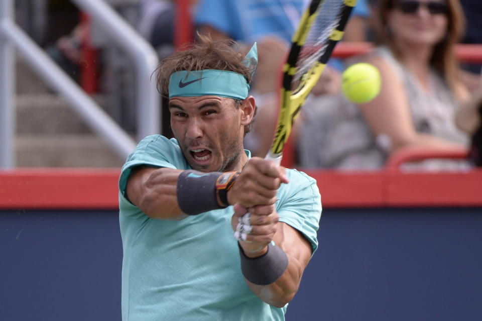 Spain's Rafael Nadal returns to Russia's Daniil Medvedev during the final of the Rogers Cup tennis tournament in Montreal, Sunday, Aug. 11, 2019. (Paul Chiasson/The Canadian Press via AP)
