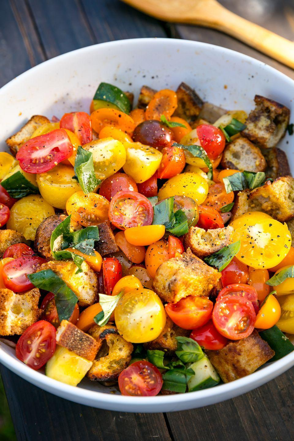 "<p>Panzan-HELL-YEA!</p><p>Get the recipe from <a href=""https://www.delish.com/cooking/recipe-ideas/recipes/a47246/summer-panzanella-recipe/"" rel=""nofollow noopener"" target=""_blank"" data-ylk=""slk:Delish"" class=""link rapid-noclick-resp"">Delish</a>.</p>"