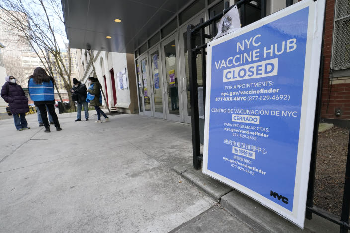 People who had appointments to get COVID-19 vaccinations talk to New York City health care workers, Thursday, Jan. 21, 2021, outside a closed vaccine hub in the Brooklyn borough of New York after they were told to come back in a week due to a shortage of vaccines. Public health experts are blaming the shortages in part on the Trump administration's push to get states to vastly expand their vaccination drives to reach the nation's estimated 54 million people age 65 and over. The push that began over a week ago has not been accompanied by enough doses to meet demand, leading to frustration and confusion. (AP Photo/Kathy Willens)