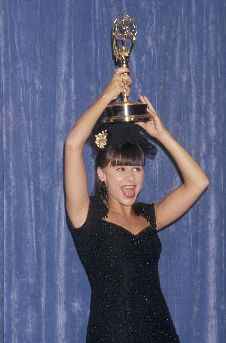 """<p>Winning for Outstanding Variety, Music or Comedy Program for """"The Tracey Ullman Show,"""" Ullman wore a black fringe dress. </p>"""