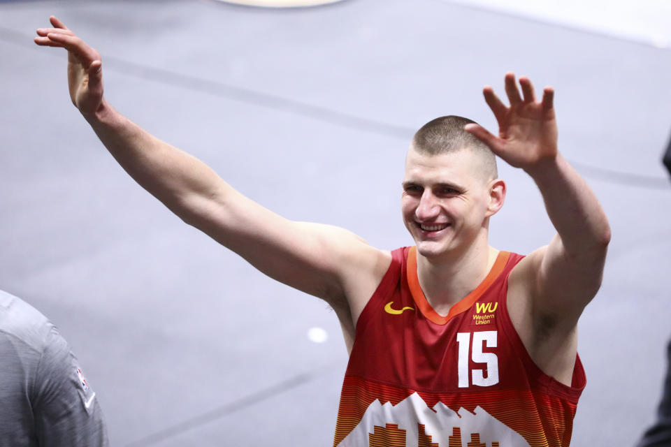 Nikola Jokic #15 of the Denver Nuggets reacts as he walks towards the locker room after their win against the New Orleans Pelicans at Ball Arena on April 28, 2021 in Denver, Colorado.
