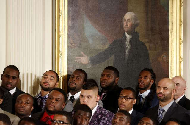 Members of the XLVIII Super Bowl Champion Seattle Seahawks listen to U.S. President Barack Obama as they are honored in the East Room of the White House in Washington May 21, 2014. REUTERS/Larry Downing (UNITED STATES - Tags: POLITICS SPORT FOOTBALL)