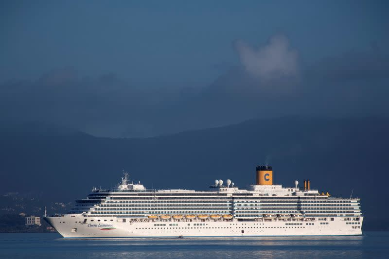 The Costa Luminosa cruise ship prepares to moor at the port of the island of Corfu