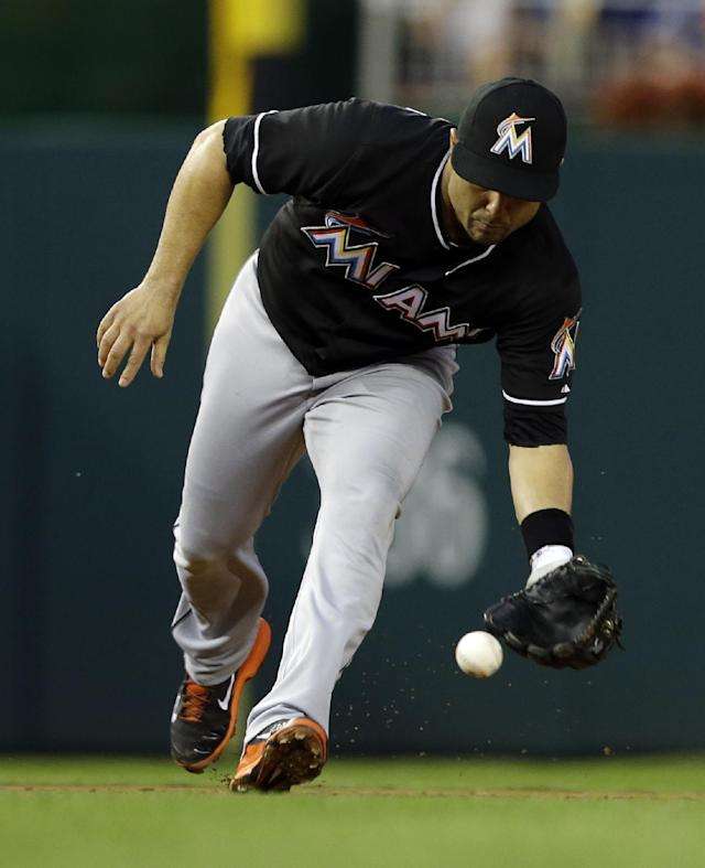 Miami Marlins third baseman Placido Polanco fields a hit by Washington Nationals' Wilson Ramos, who was out at first base, during the second inning of a baseball game at Nationals Park, Thursday, Aug. 29, 2013, in Washington. (AP Photo/Alex Brandon)