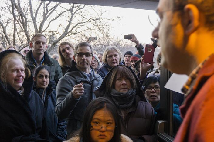 Congressman Justin Amash, right, speaks to people being turned away at the door because of overcrowding before the start of a town hall meeting at City High Middle School in Grand Rapids, Mich., Thursday, Feb. 9, 2017. (Mike Clark/The Grand Rapids Press via AP)