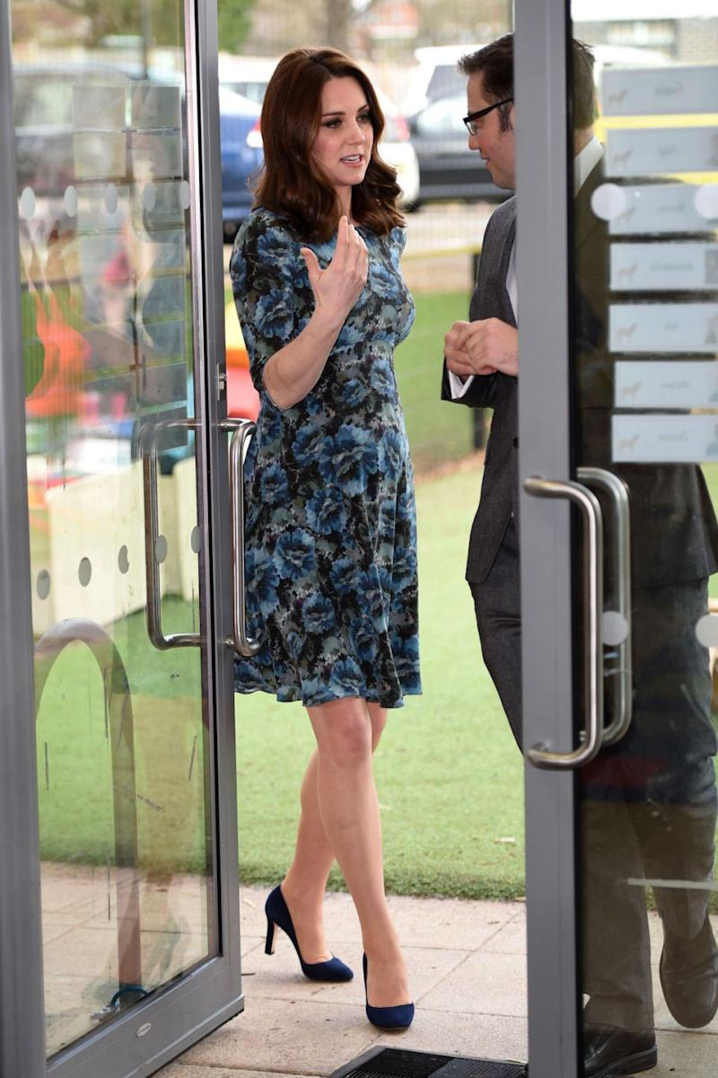 Kate had her bump on show in the fitted dress. Photo: Getty