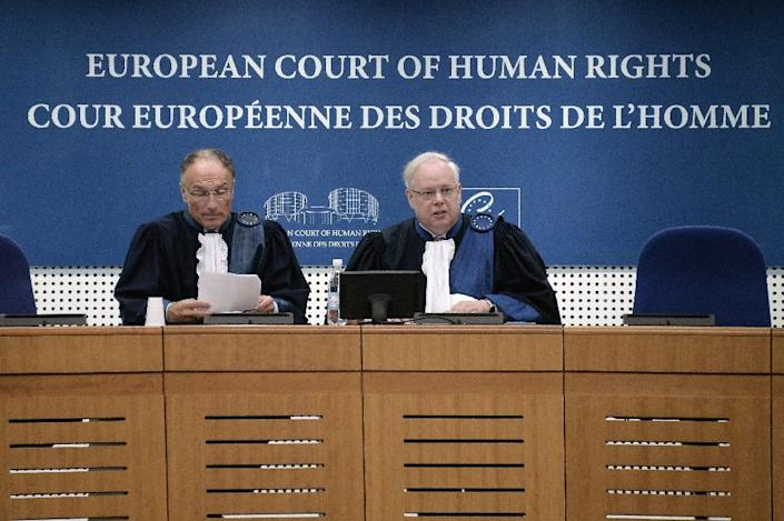 Luxembourg President of the European Court for Human Rights Dean Spielmann (R) speaks on October 15, 2015 at the court in Strasbourg, eastern France (AFP Photo/Frederick Florin)