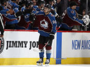 Colorado Avalanche center Vladislav Namestnikov is congratulated as he passes the team box after scoring a goal against the New York Rangers during the second period of an NHL hockey game Wednesday, March 11, 2020, in Denver. (AP Photo/David Zalubowski)
