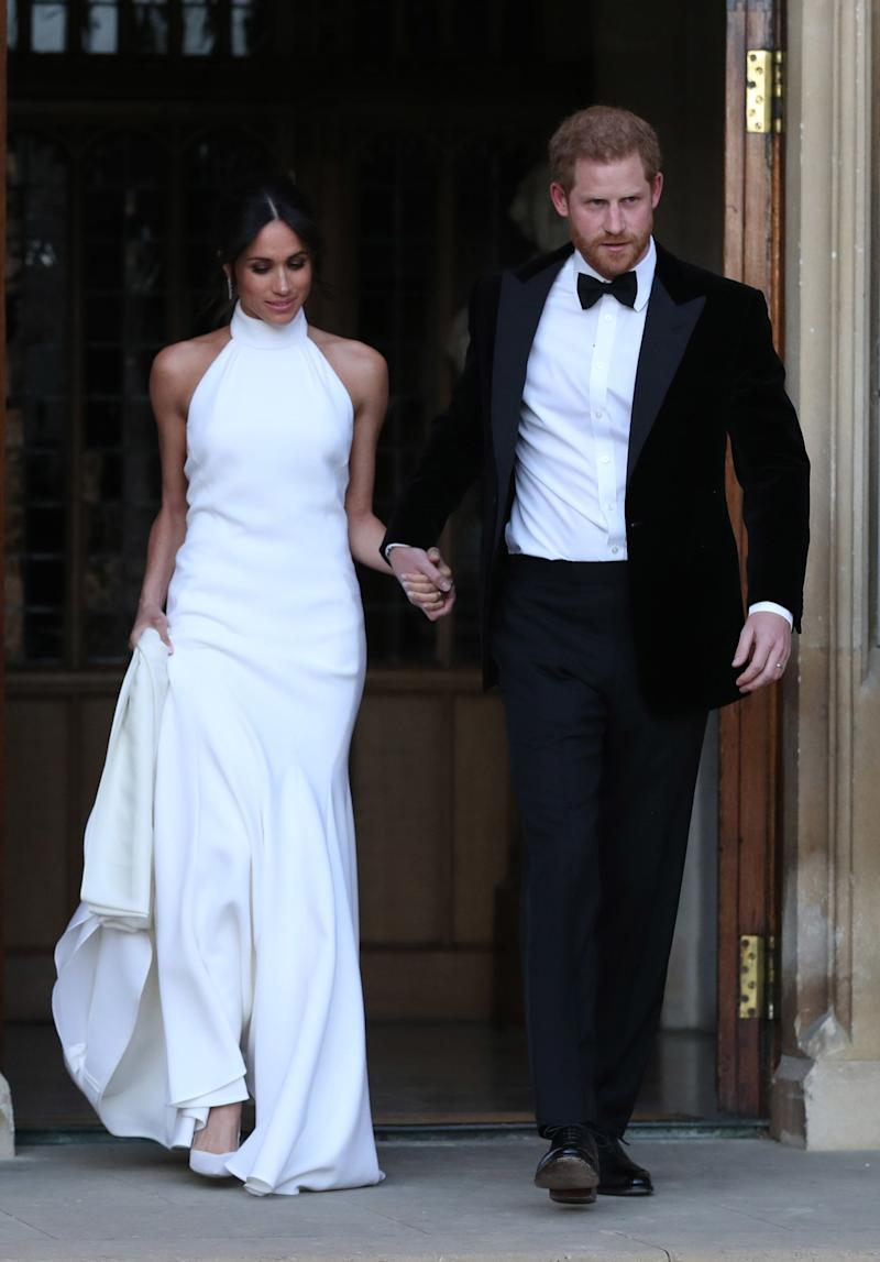The Duchess of Sussex and Prince Harry, Duke of Sussex, leave Windsor Castle after their wedding to attend an evening reception at Frogmore House, hosted by Prince Charles, Harry's father, on May 19.