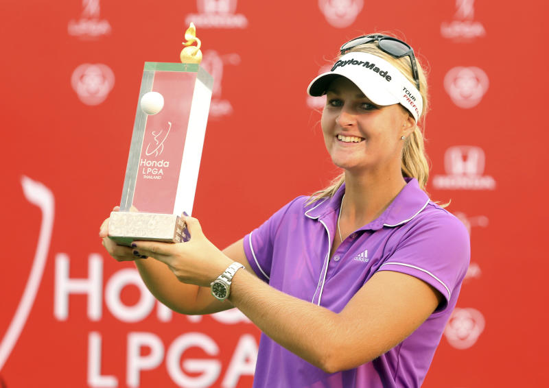 Anna Nordqvist of Sweden shows off her winner's trophy during the awarding ceremony of the LPGA Thailand golf tournament in Pattaya, southern Thailand, Sunday, Feb. 23, 2014.(AP Photo/Siamsport Newspaper) THAILAND OUT
