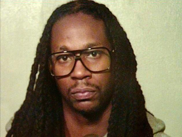 This photo provided by the Oklahoma County Sheriff's Office shows Rapper 2 Chainz. 2 Chainz was one of 11 people arrested after refusing to get off a tour bus for almost nine hours following a traffic stop in Oklahoma City early Thursday morning, Aug. 22, 2013, police said. 2 Chainz, whose real name is Tauheed Epps, was arrested Thursday morning along with 10 other people on a charge of obstructing a police officer, Sgt. Jennifer Wardlow said. (AP Photo/Oklahoma County Sheriff's Office)