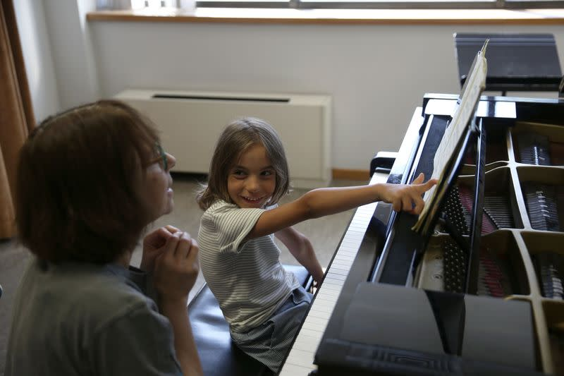 Stelios Kerasidis, 7-year-old pianist and composer, pauses during a lesson at the Athens Megaron Concert Hall in Athens